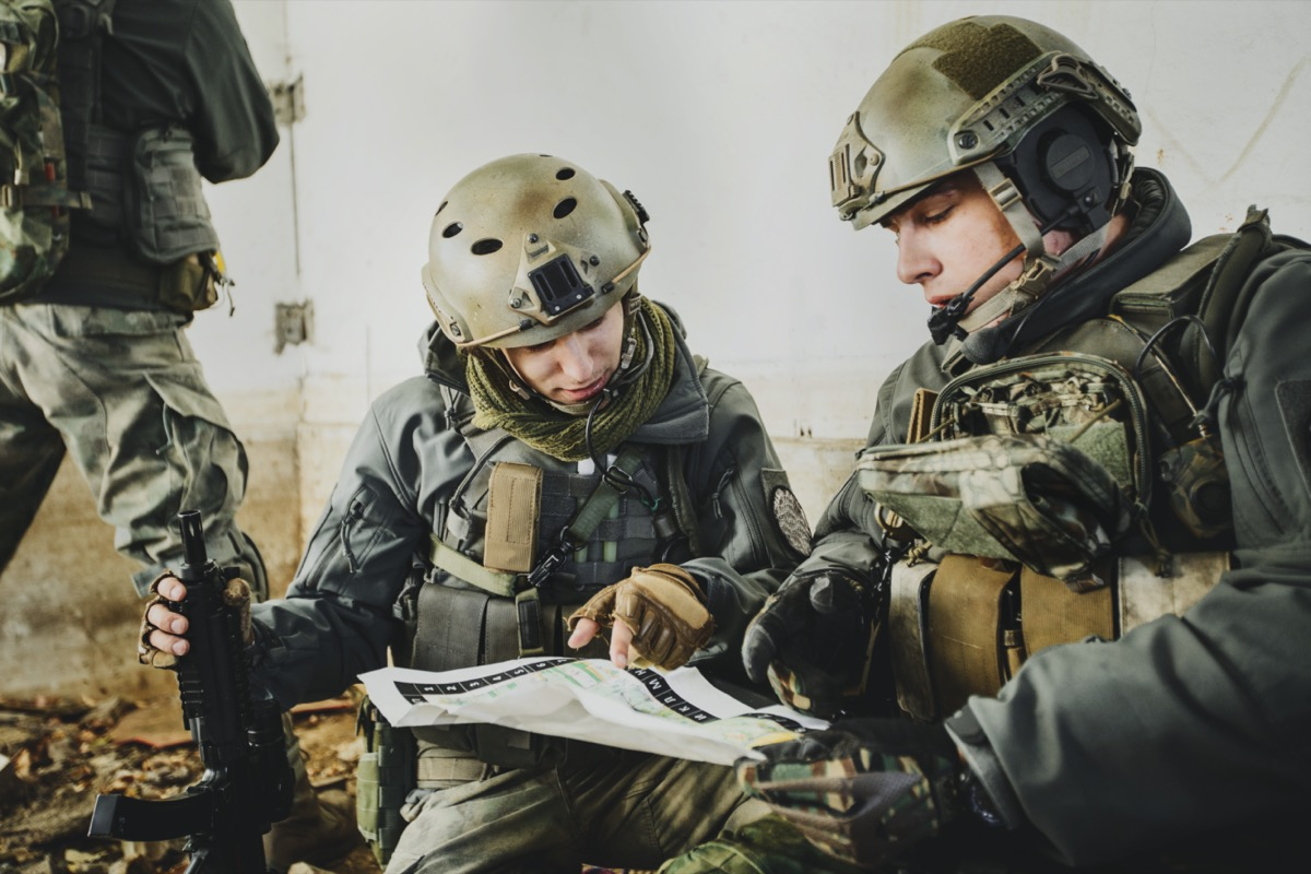 two military men going over a plan