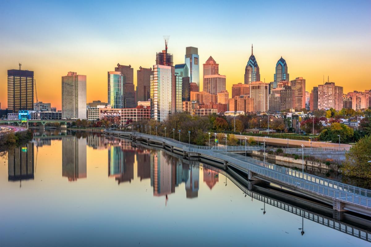 city skyline and the Schuylkill River in Philadelphia, Pennsylvania at dusk