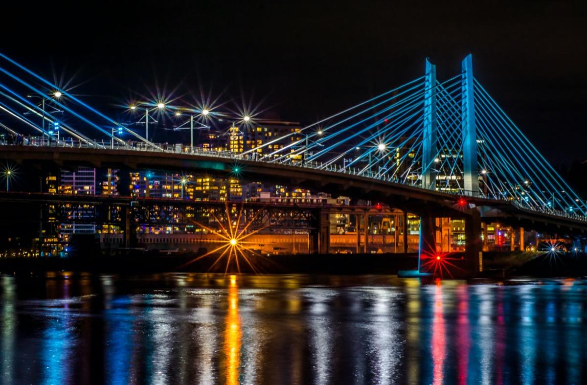 cityscape photo of bridge above lake and building in Portland, Oregon at night
