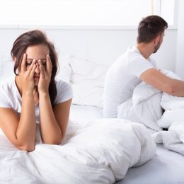 Couple fighting in bed bad sleep position