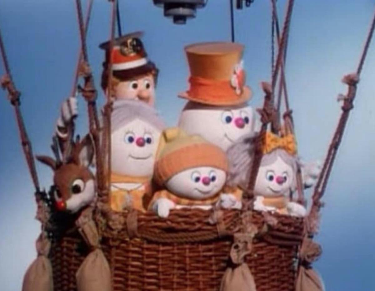 snowmen in hot air balloon basket