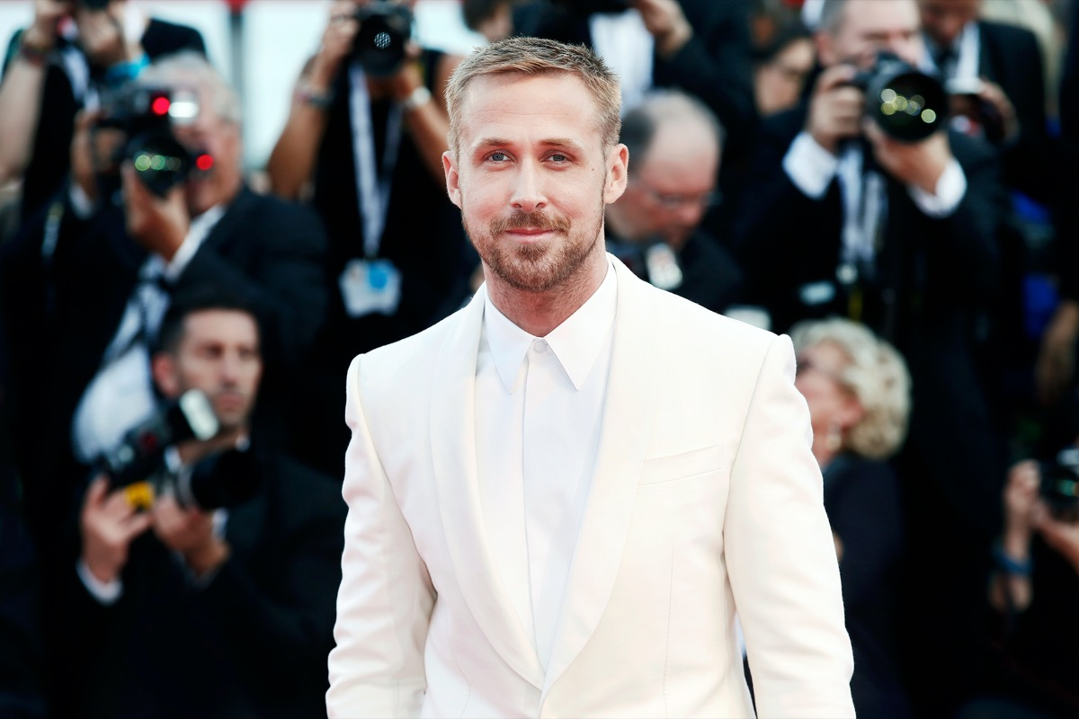 """Ryan Gosling wears a white suit to the premiere of """"First Man"""" in 2018"""