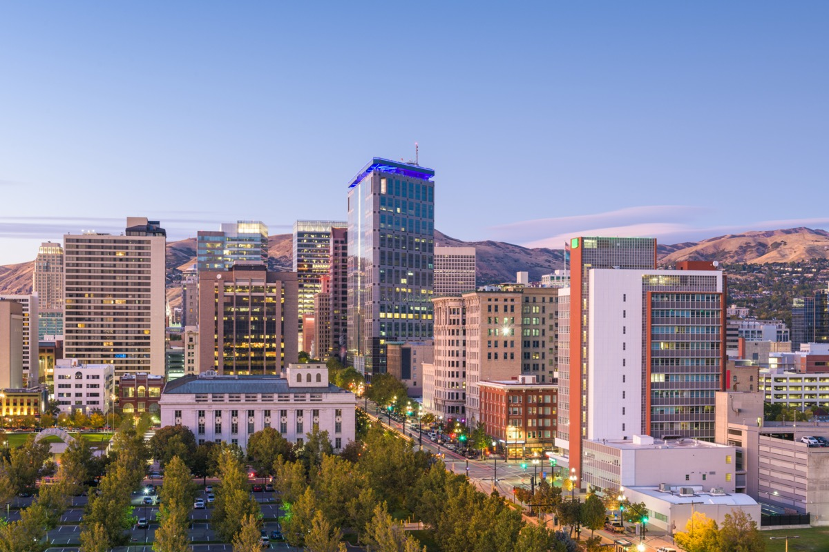 cityscape photo of trees, buildings, and brown mountains in Salt Lake City, Utah
