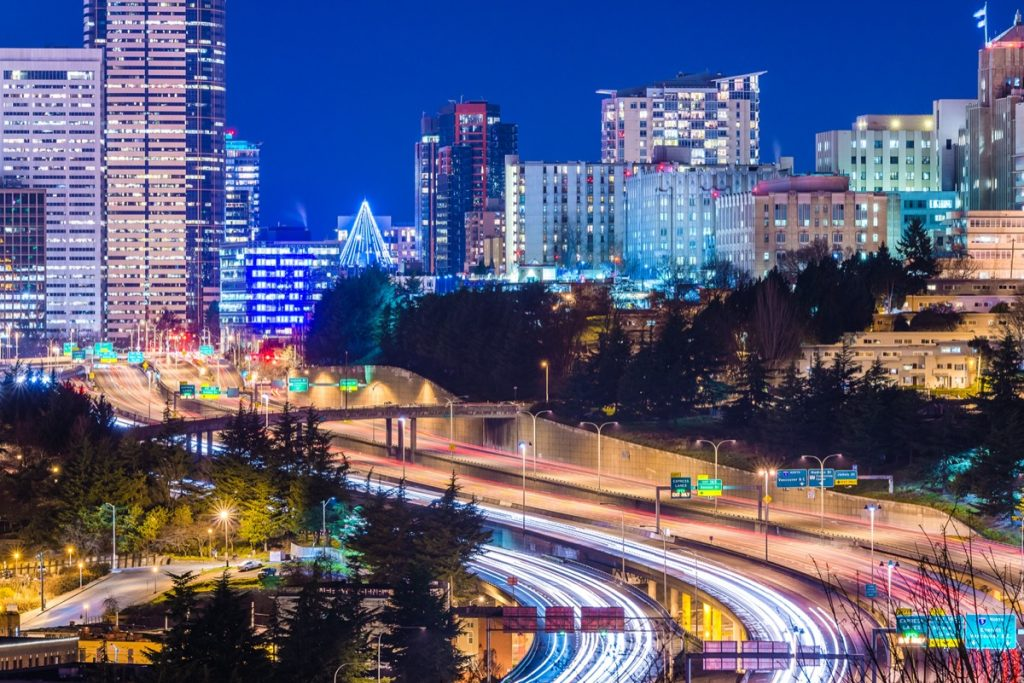 city skyline and busy highway in Seattle, Washington at night