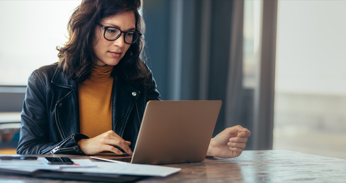 Woman online shopping on Cyber Monday with laptop