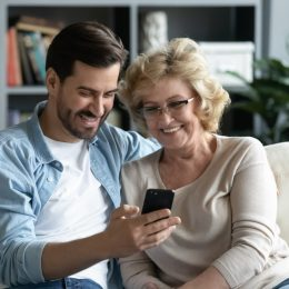 Mother and son looking at phone