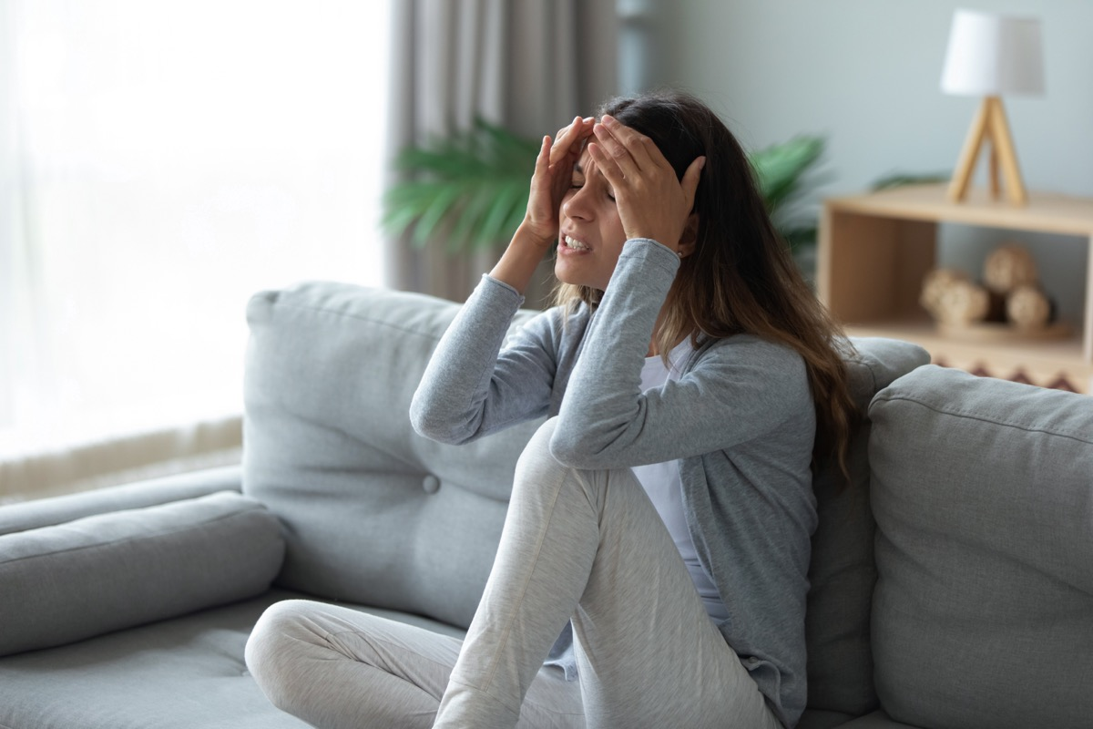 Woman experiencing side effects from COVID vaccines