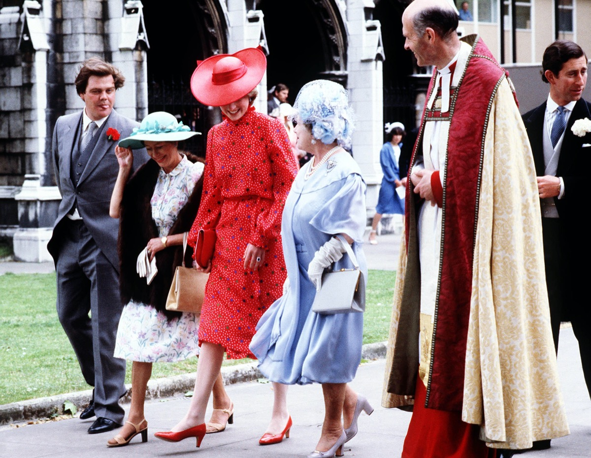 Princess Diana wearing red dress and hat at the Soames Wedding in 1981