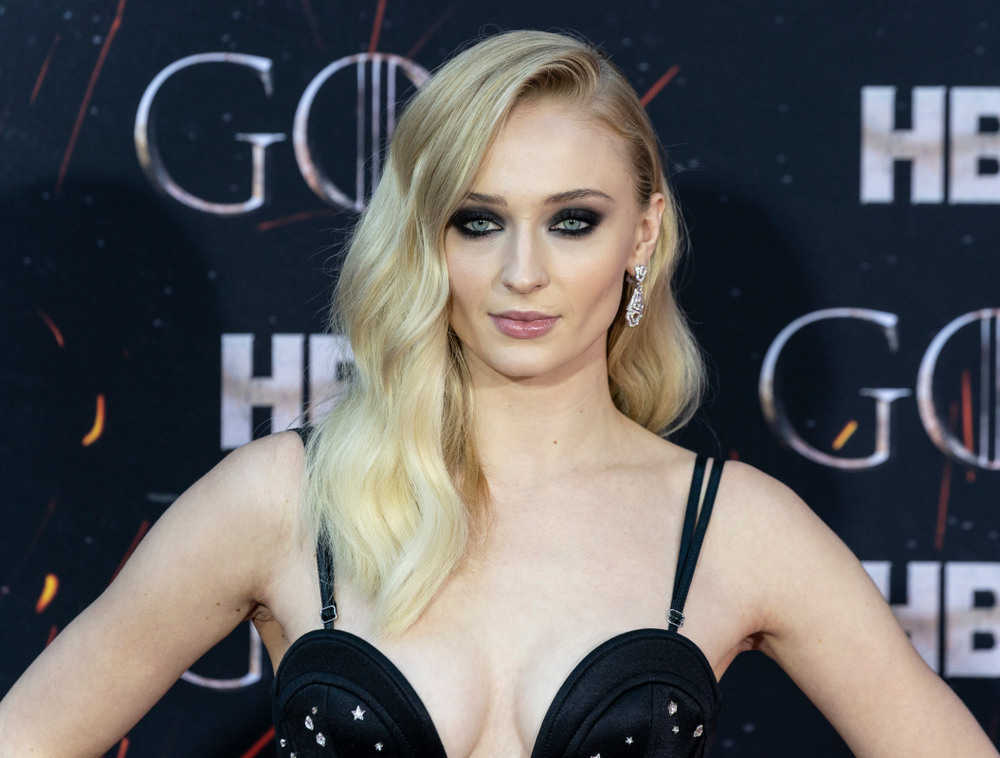 Actor Sophie Turner on the red carpet at a Game of Thrones event.