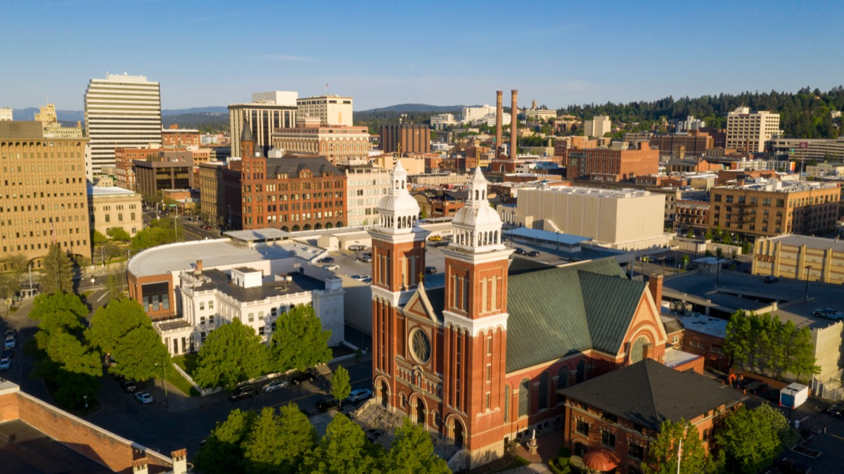 cityscape photo of a church, buildings, and trees in Spokane, Washington