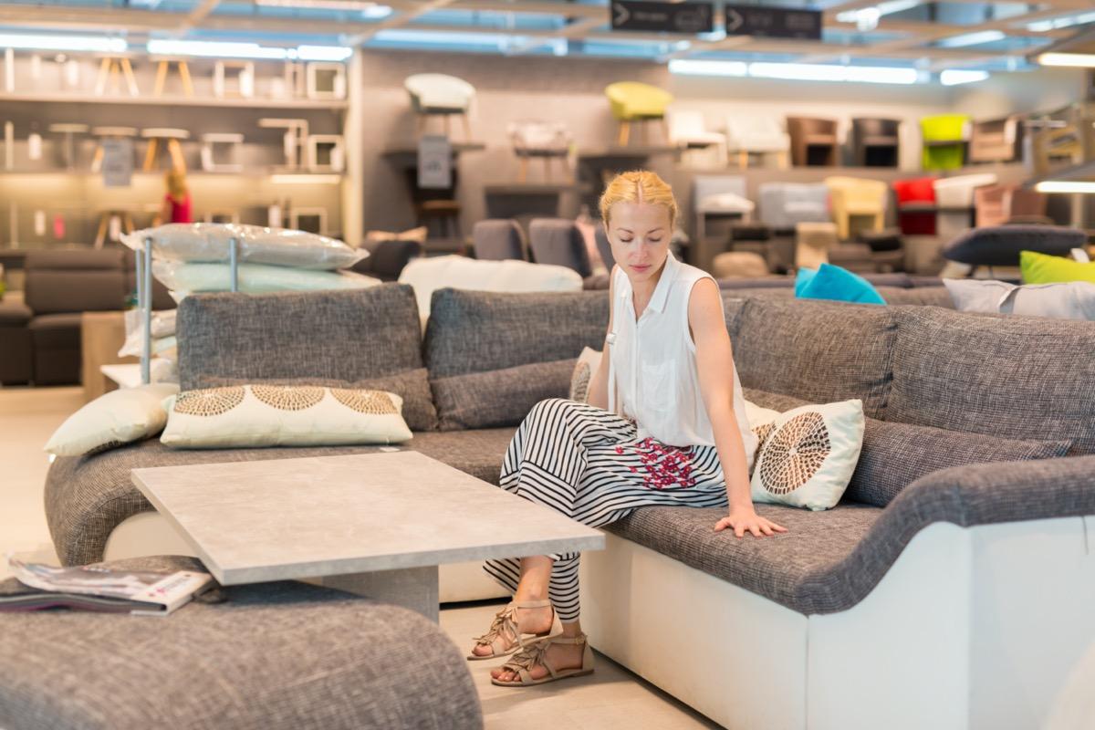 young white woman furniture shopping