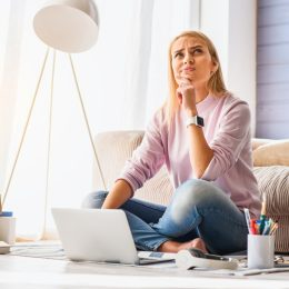 woman looking upset at computer in modern home