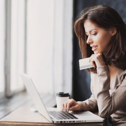 young woman shopping online with credit card