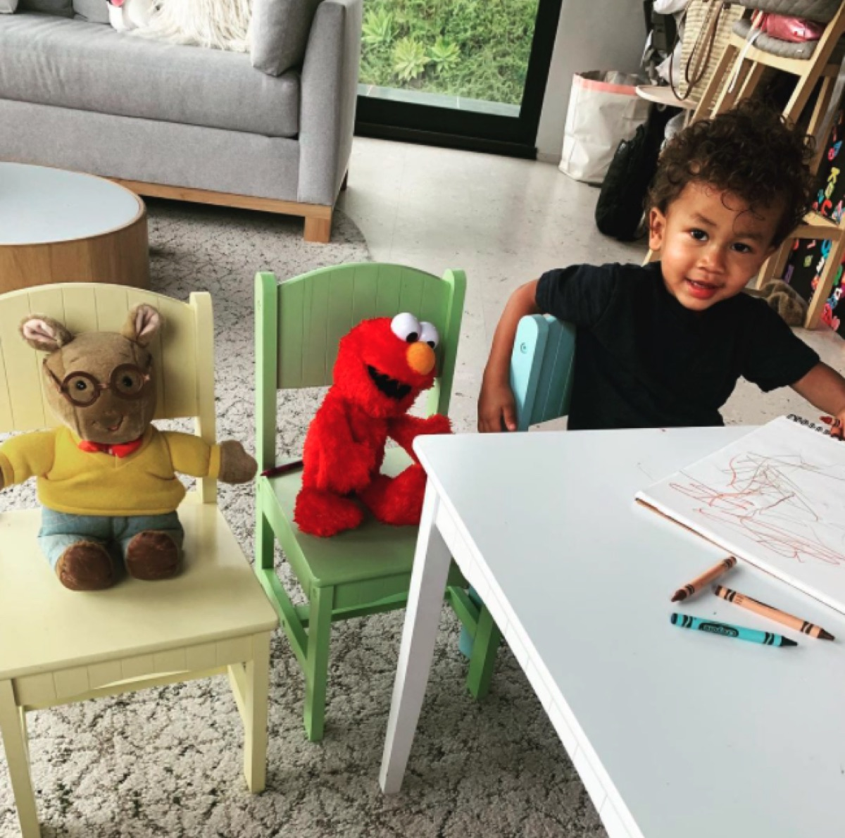 Miles Stephens with Elmo and Arthur toys