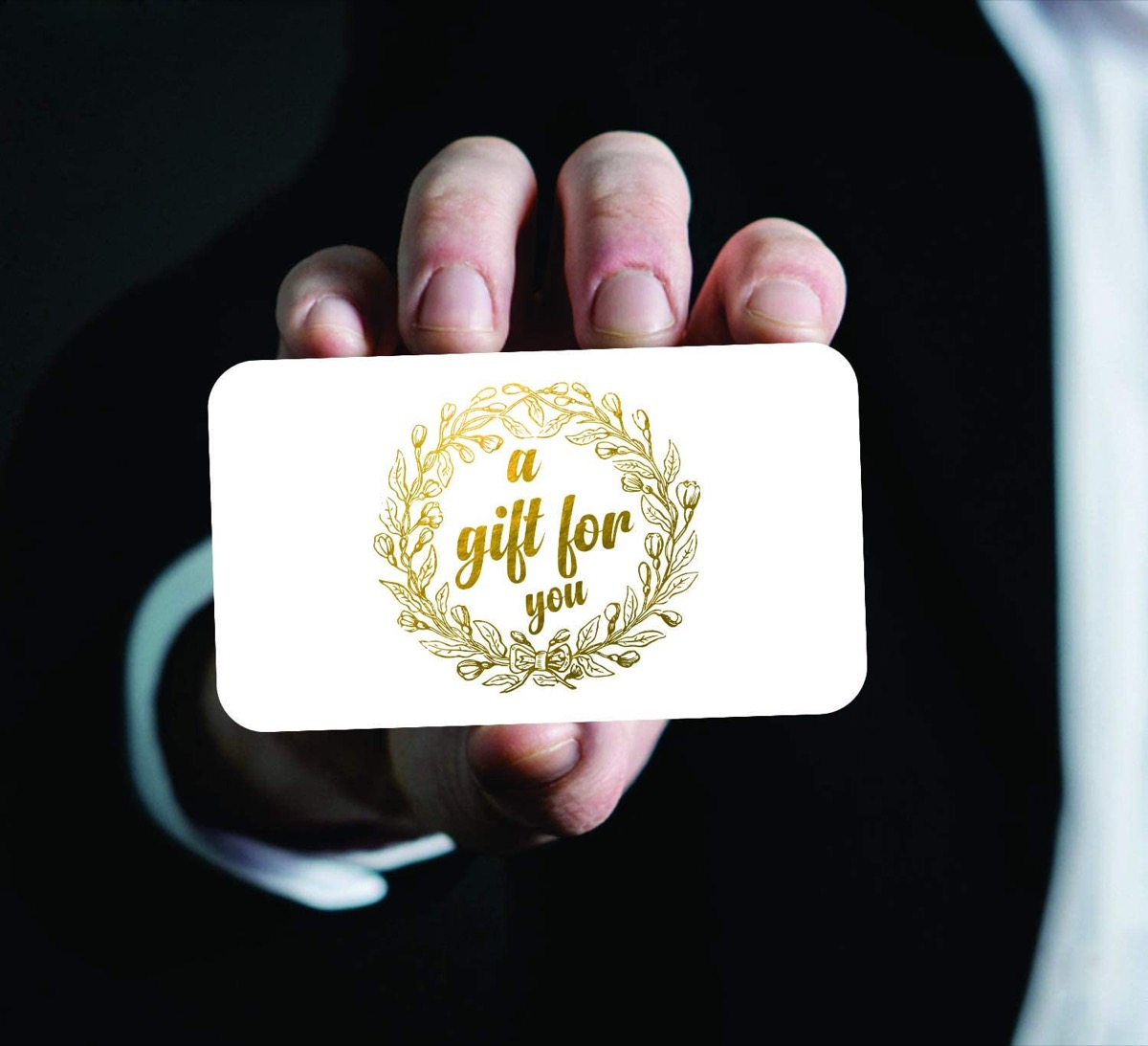 Hand holding gold and white gift vouchers