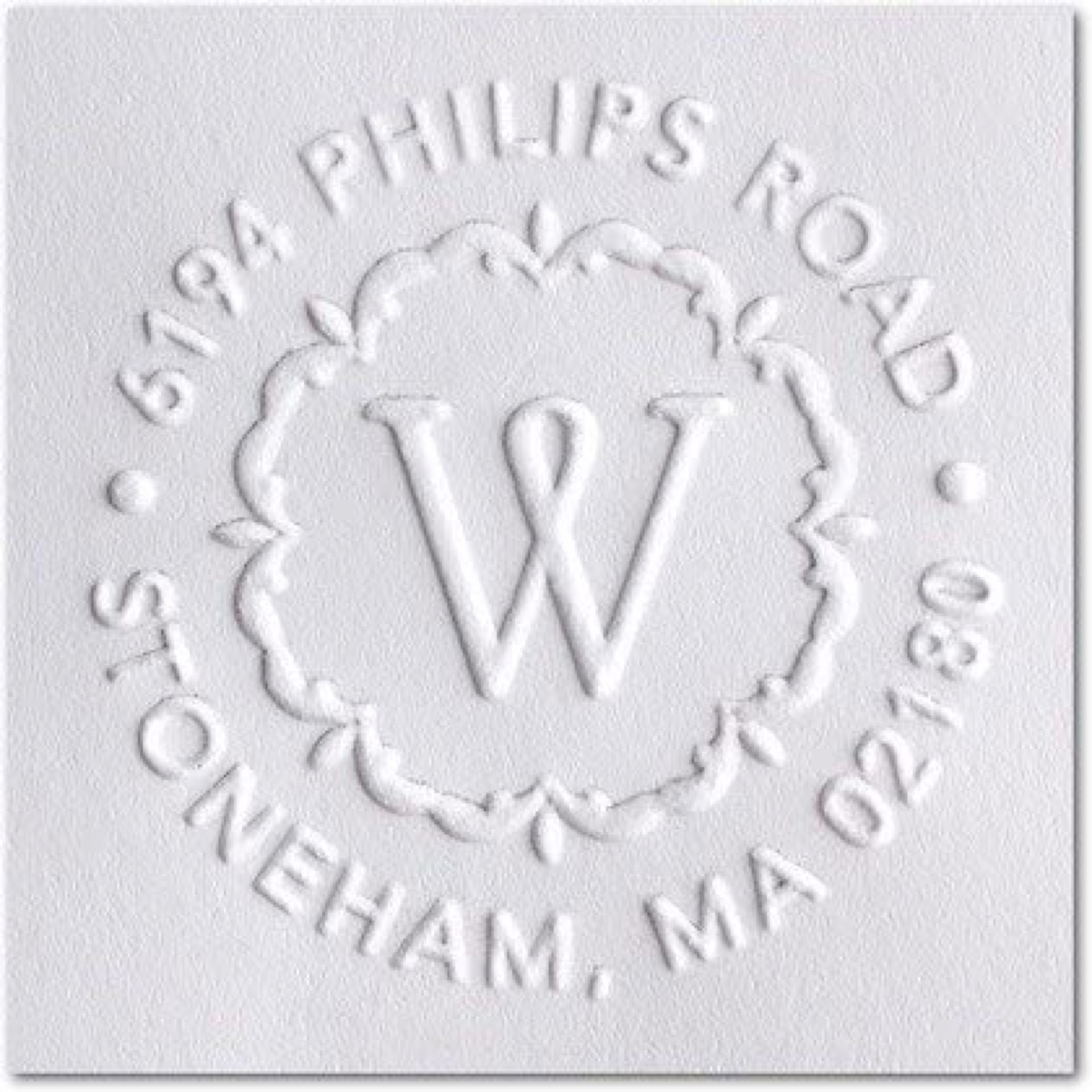 Hand embossed monogram and address
