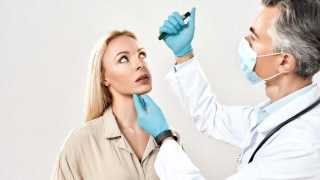 Woman receiving eye exam