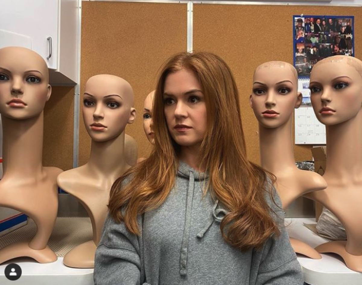 Isla Fisher with mannequin heads
