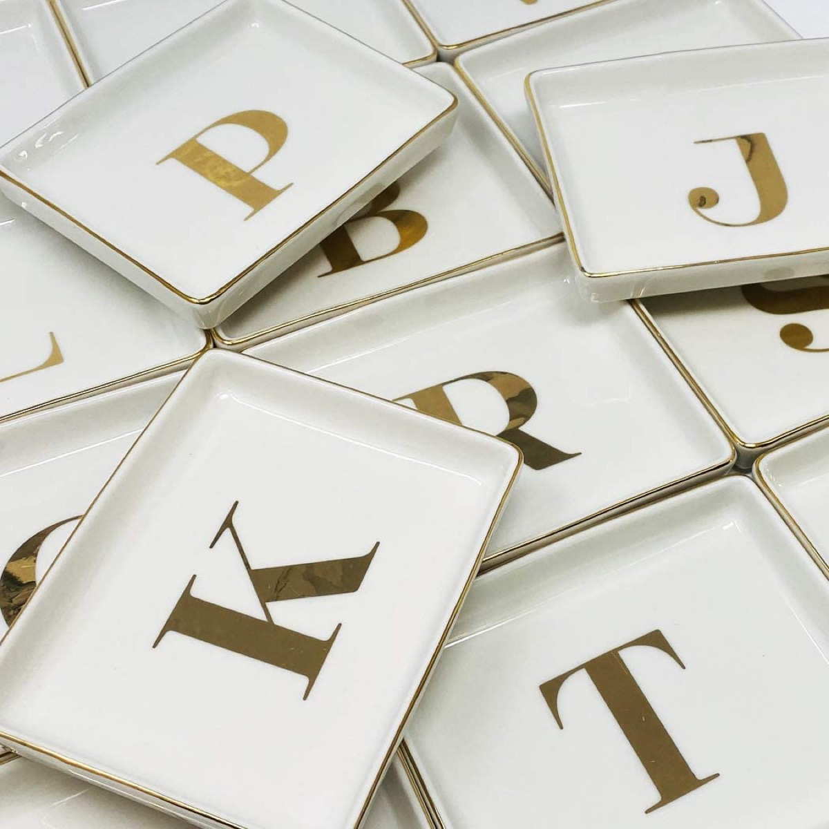 Pile of jewelry trays with initials