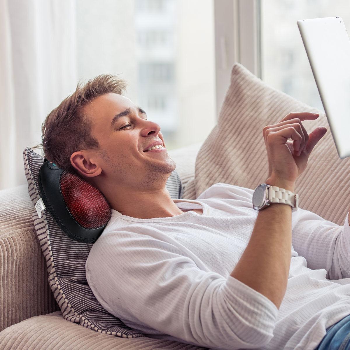 Man using shiatsu pillow massager