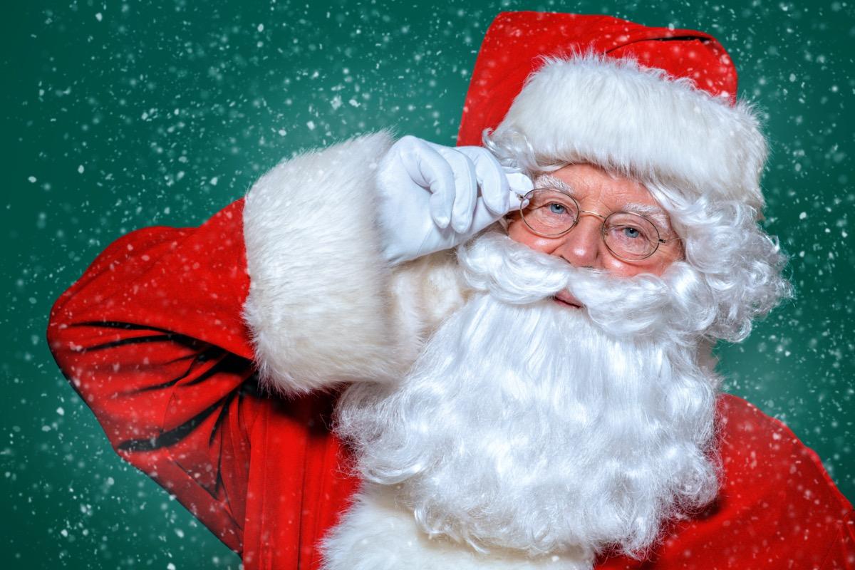 Santa Claus against green background
