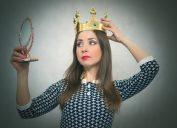 Selfish woman wearing a crown
