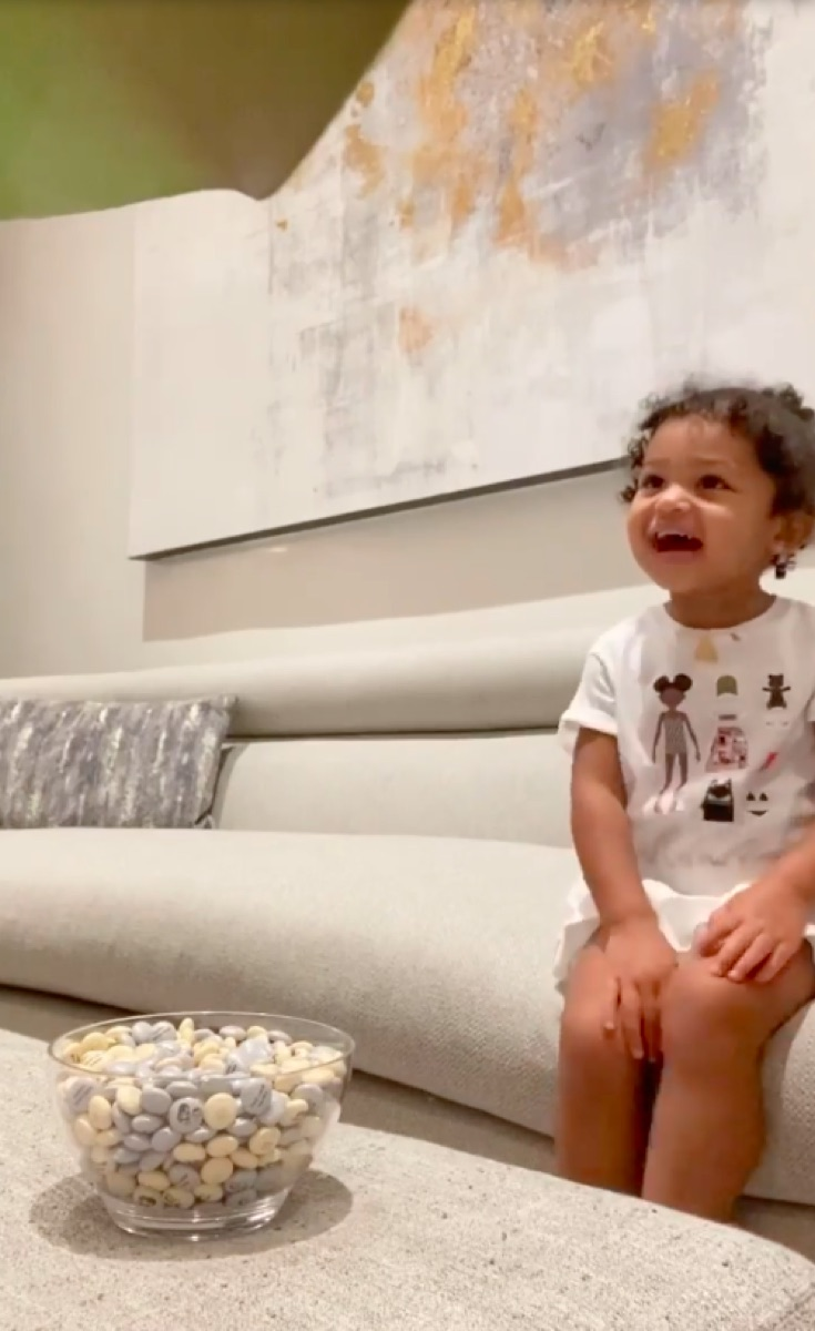 Kylie Jenner's daughter Stormi looking at bowl of candy