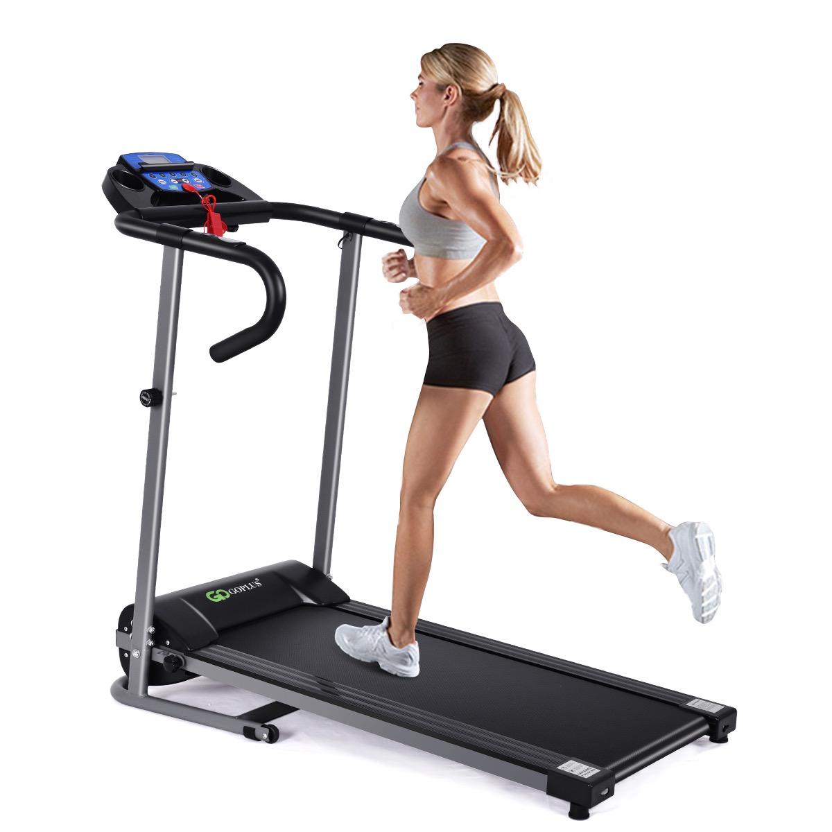 Woman running on folding treadmill