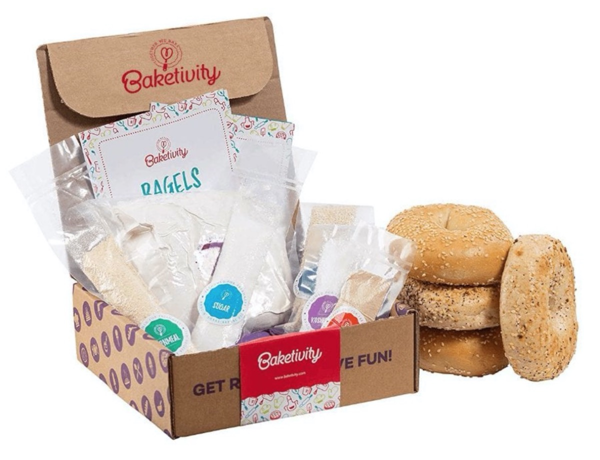 open cardboard box next to stack of bagels
