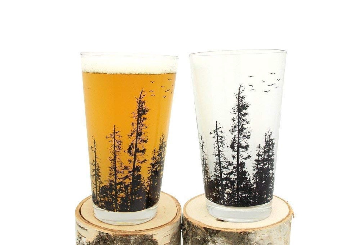 pint glasses with trees on them