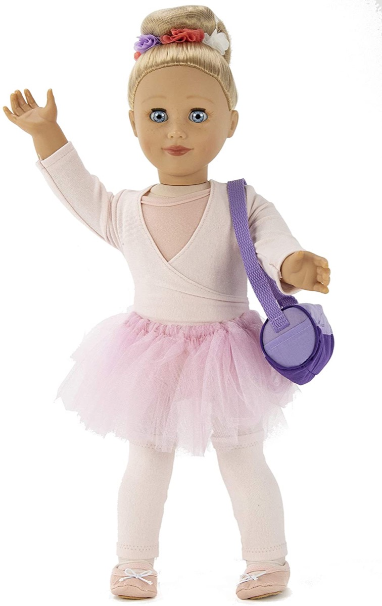 ballerina doll in pink outfit with purple bag