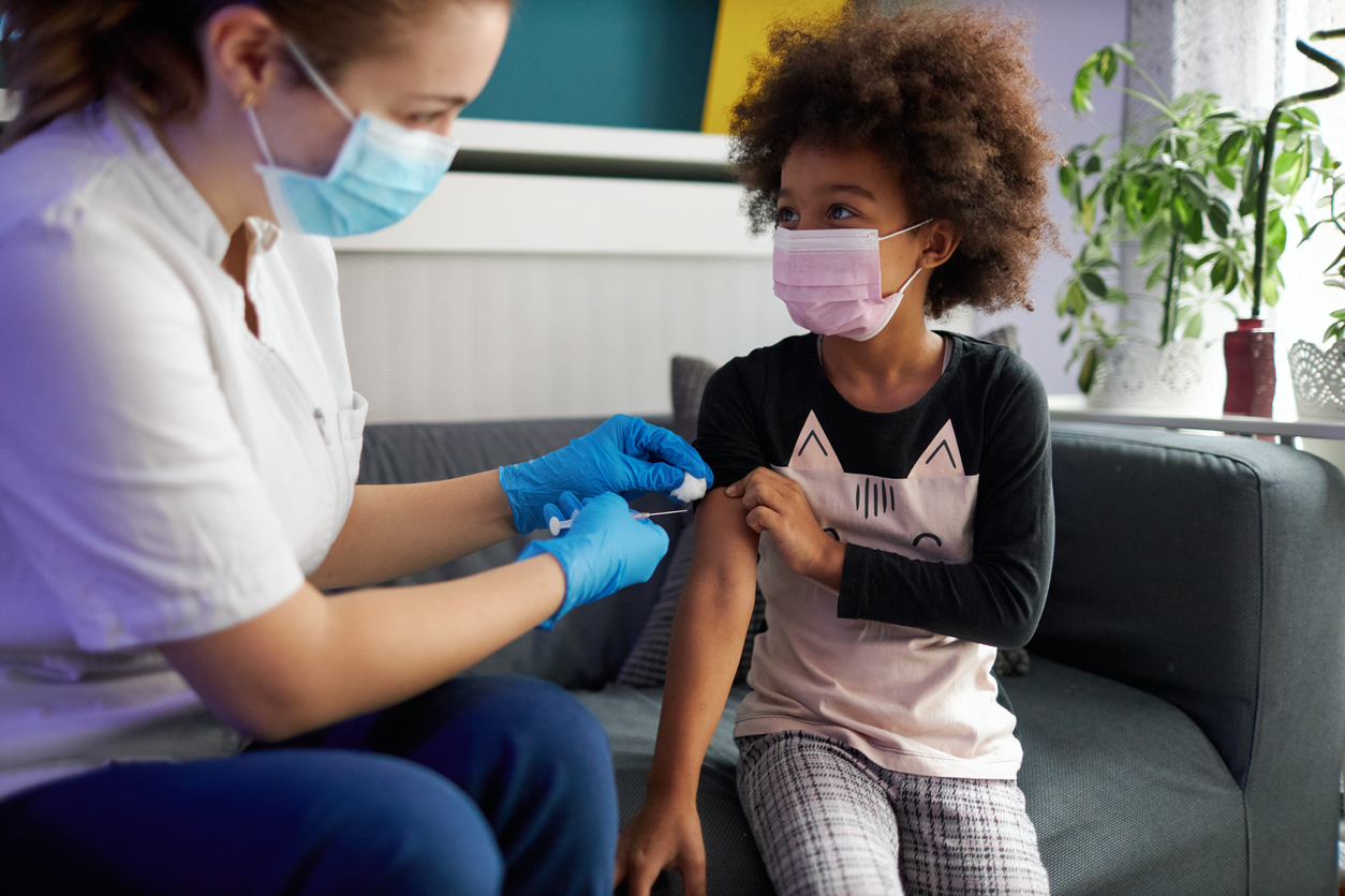 young girl getting vaccinated at home during pandemic times.