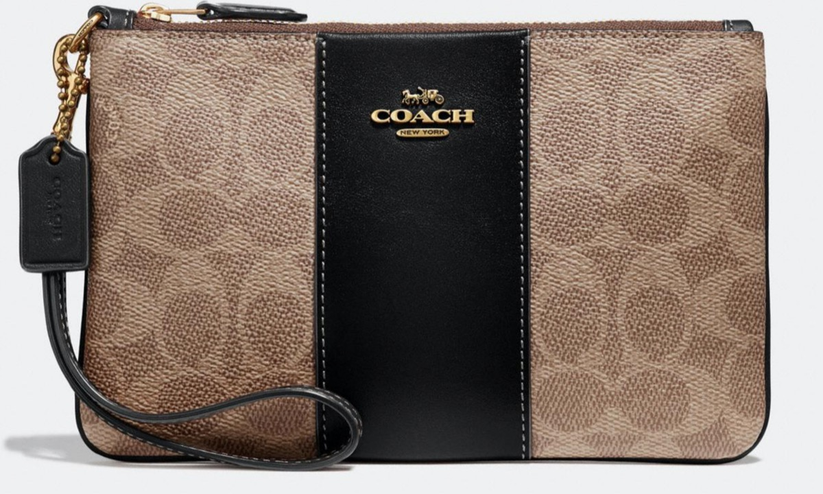 brown coach wristlet with black central band