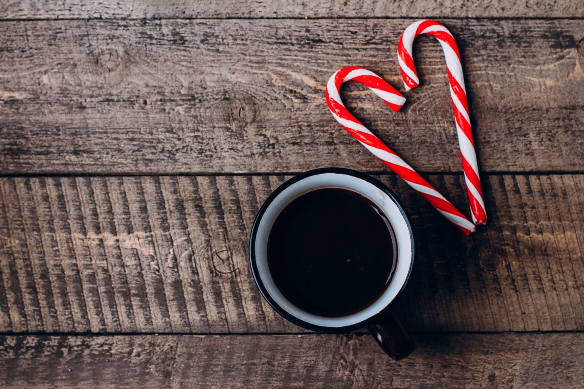 coffee and candy canes on wooden background