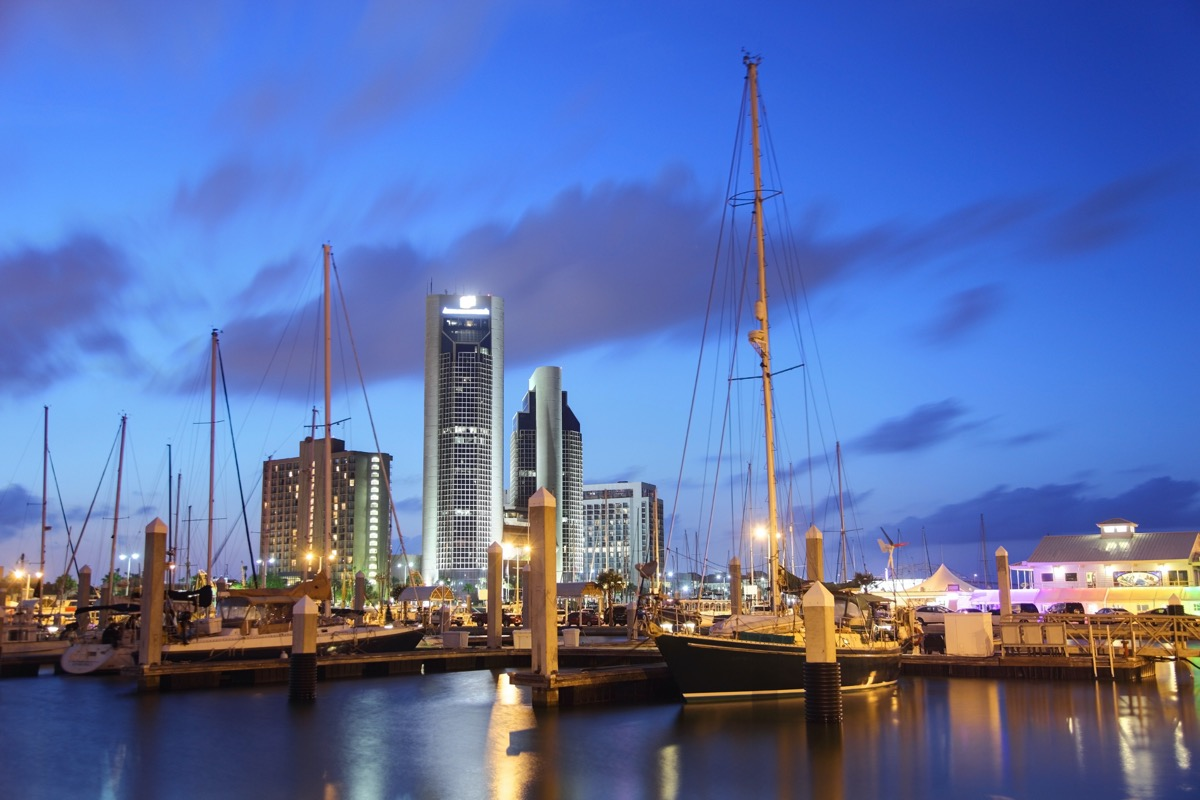 cityscape photo of buildings, boats, and piece in Corpus Christi, Texas