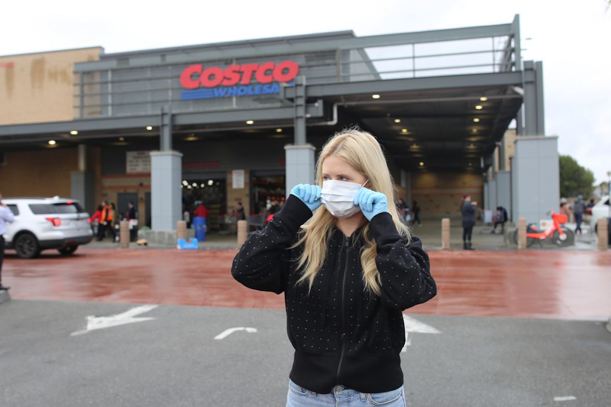 woman wearing face mask and gloves at costco grocery store
