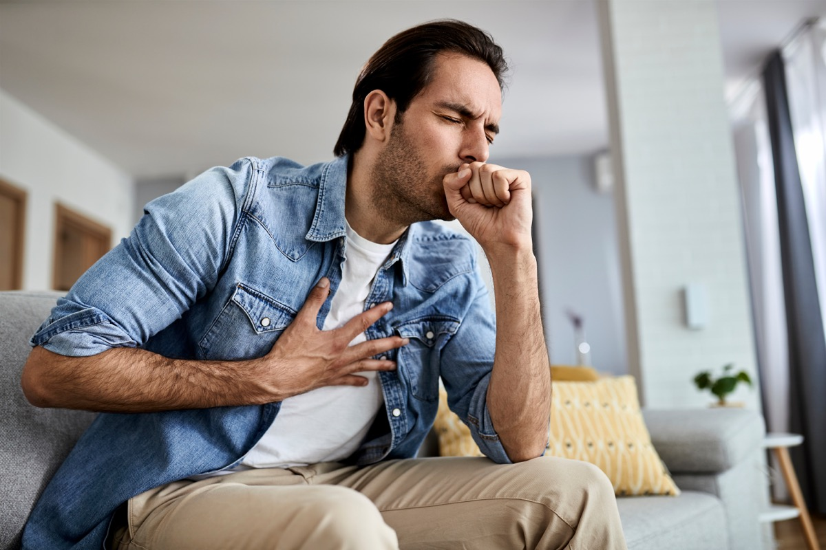Man coughing at home