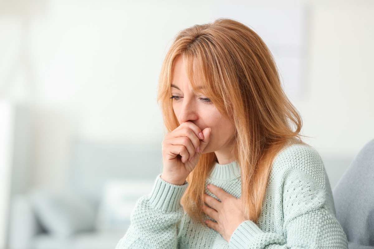 Woman with COVID coughing