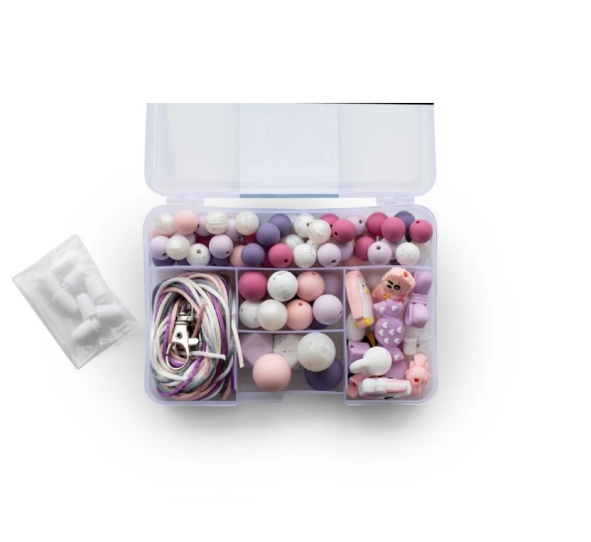 pink and purple silicone beads in clear box