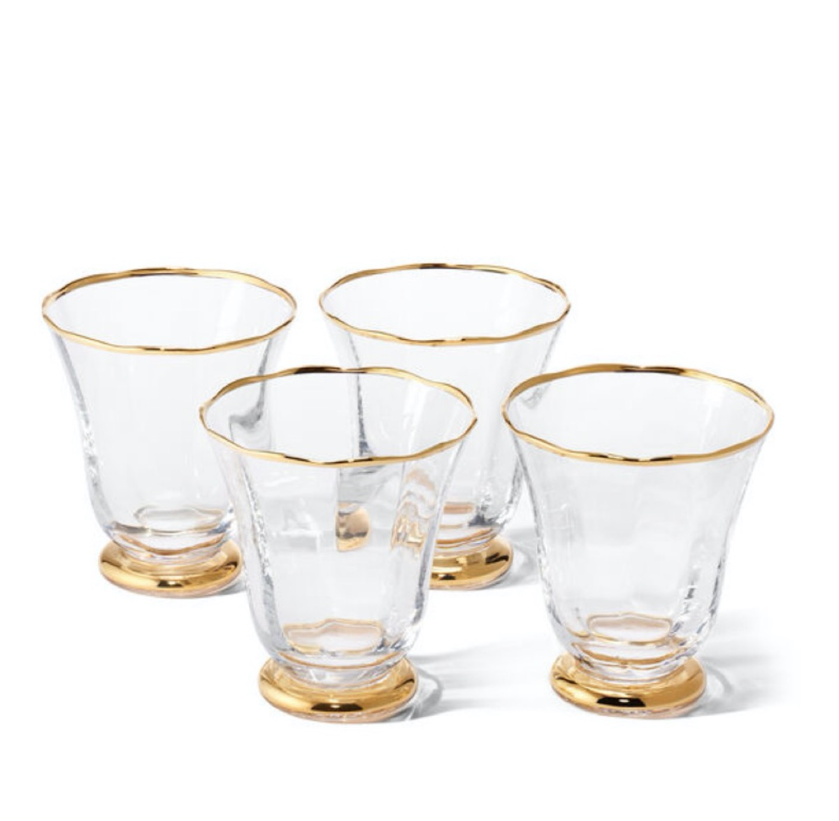 four short glasses with gold rims