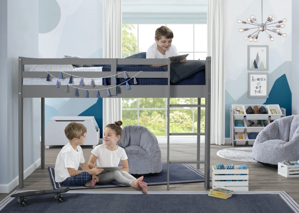 children playing on and under gray loft bed