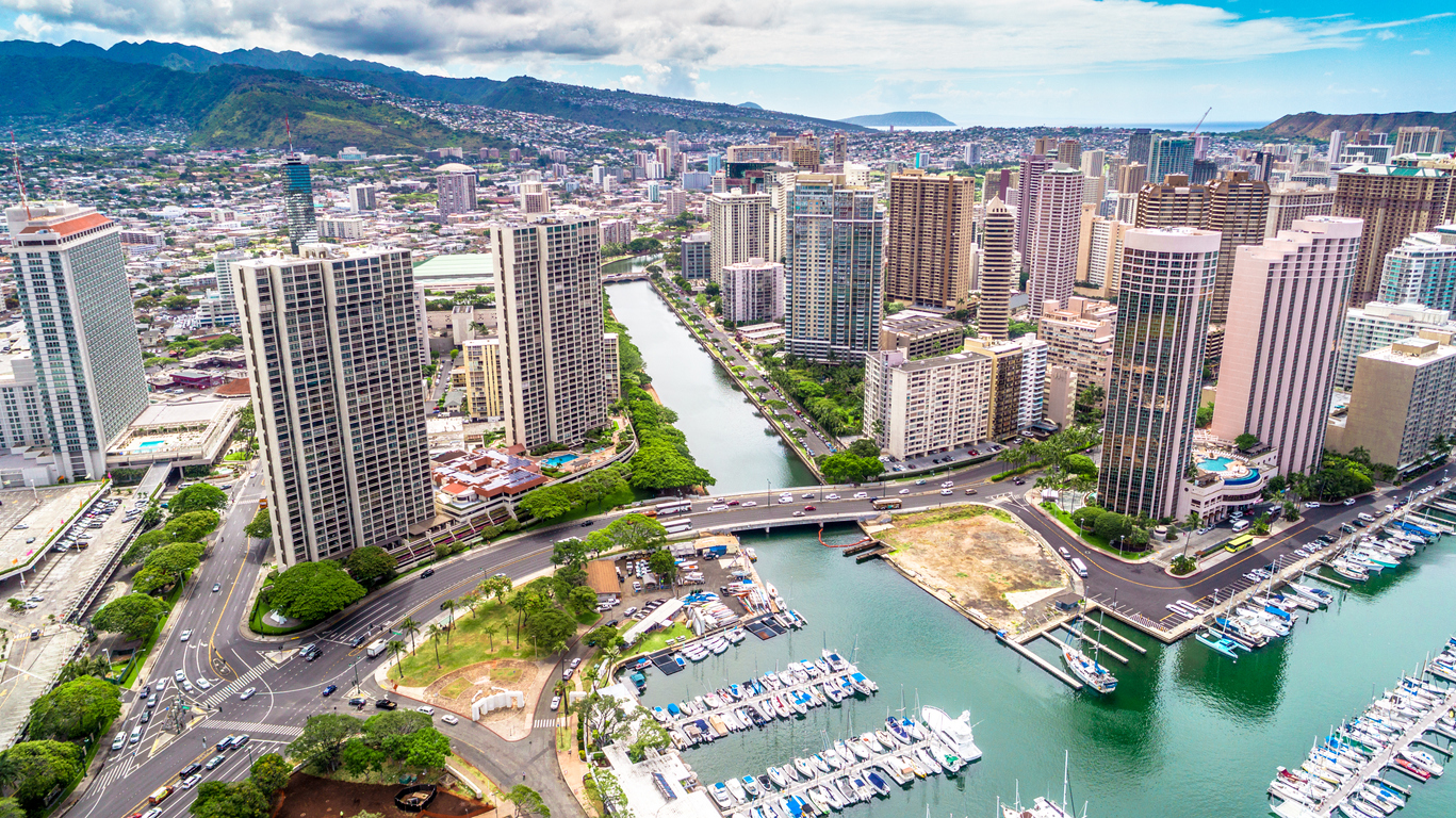 An aerial shot of downtown Honolulu, Hawaii from the water looking inland.