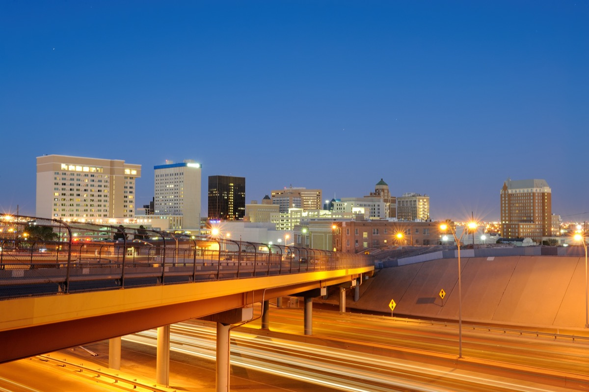 cityscape photo of highway, buildings, and bridge in downtown El Paso, Texas at night
