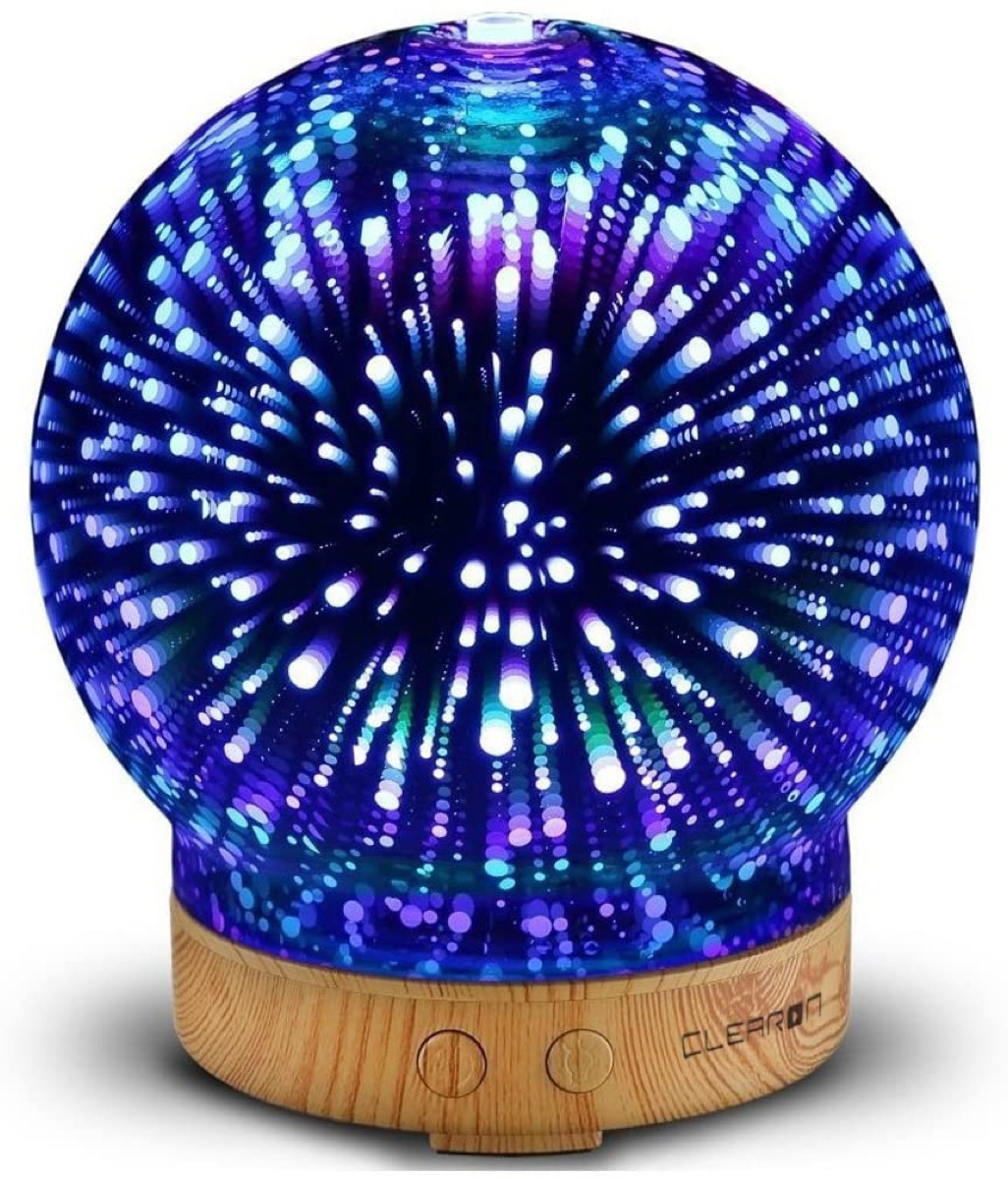 blue glass orb essential oil diffuser on wooden base