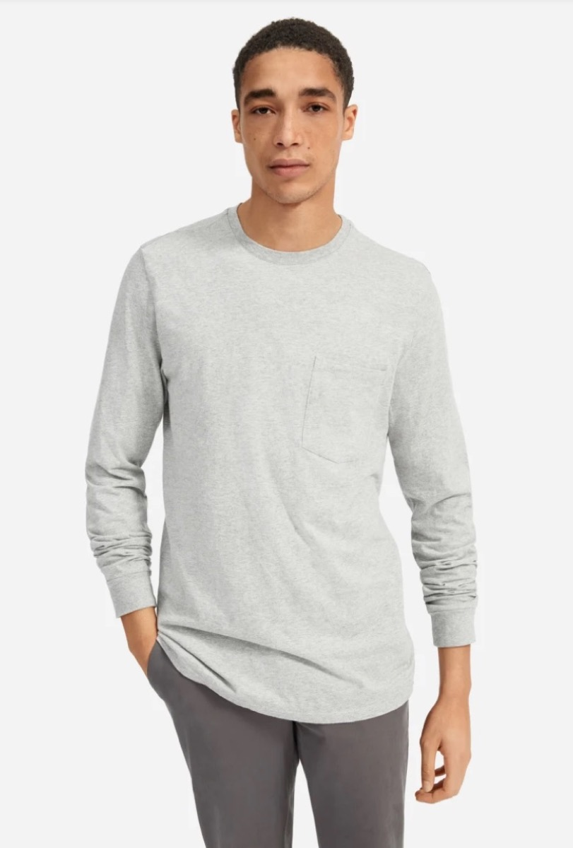 young man in long-sleeved gray t-shirt