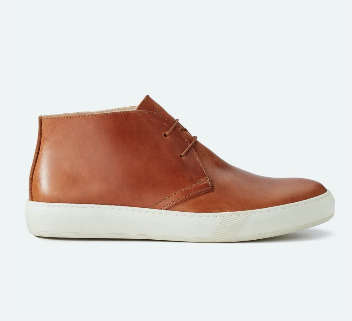 low brown leather boots with laces and white soles