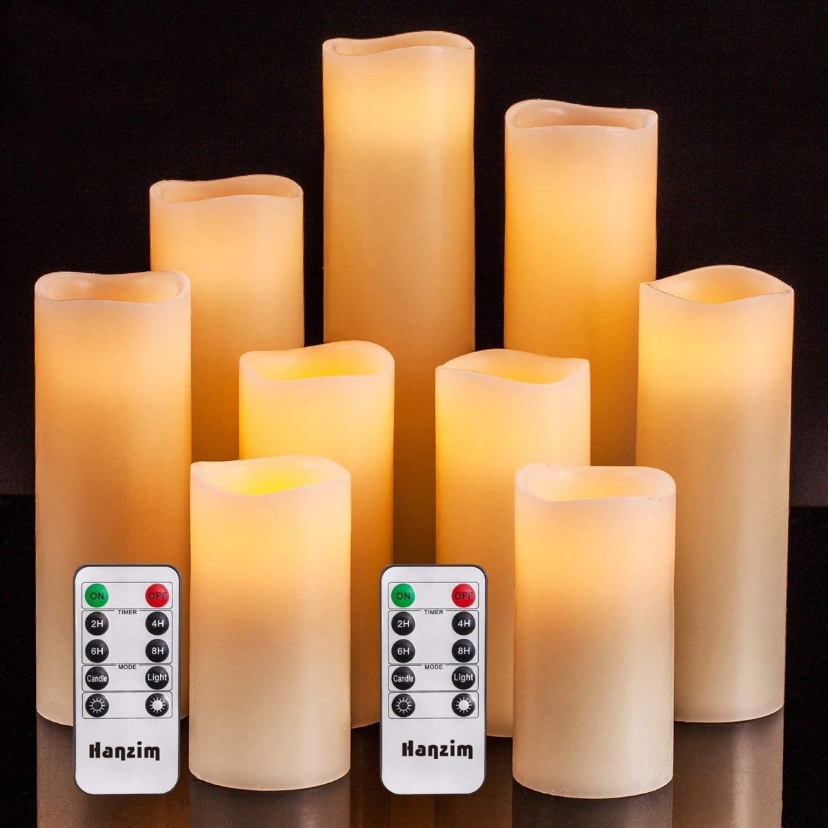 set of nine off white flameless candles and remotes