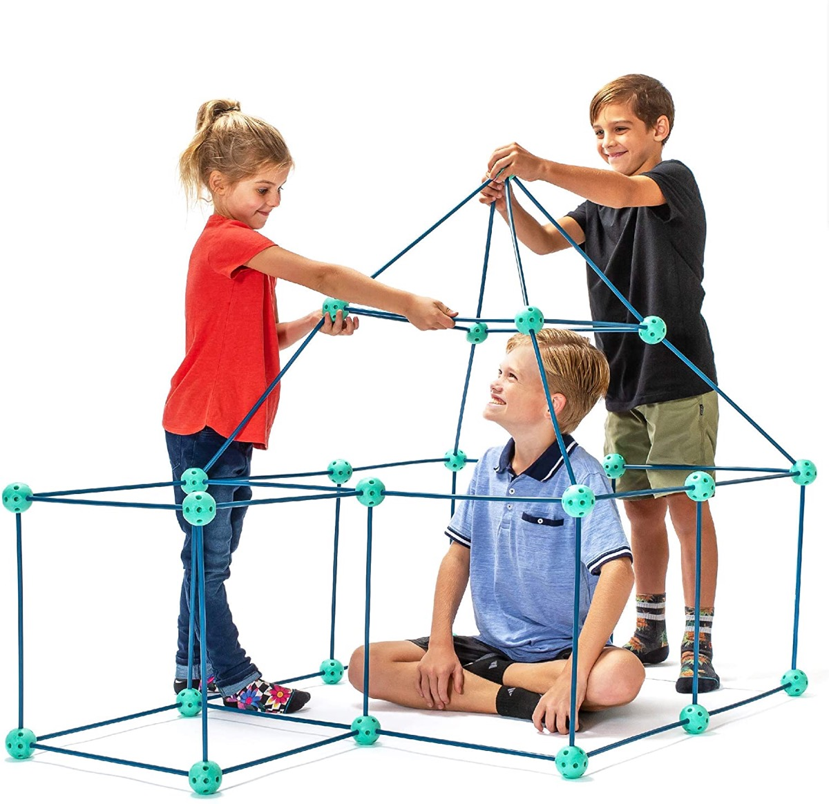 children building fort with green pieces