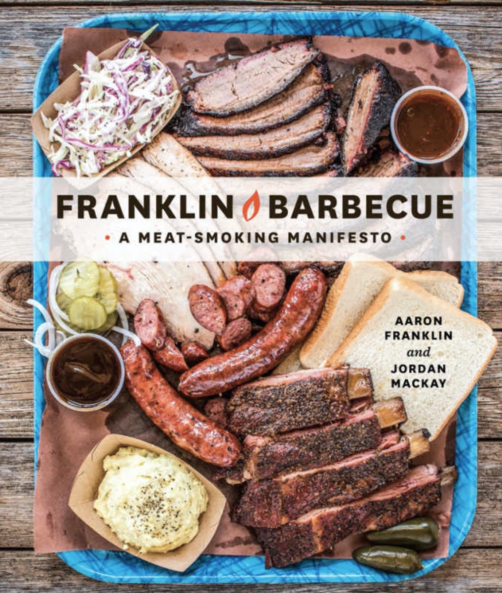franklin barbecue cookbook with meats and mashed potatoes and pickles and bread on the cover