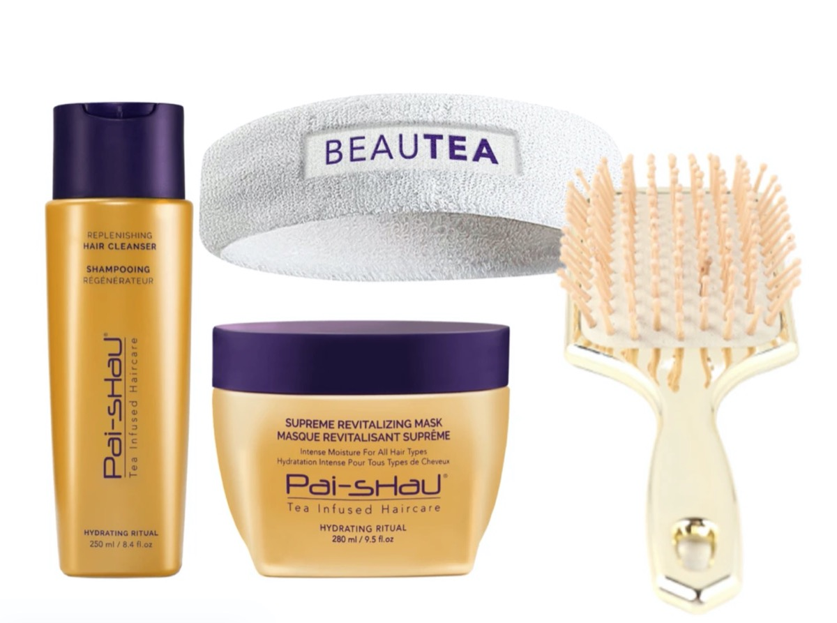 bottles of shampoo and conditioner, white headband, and gold brush